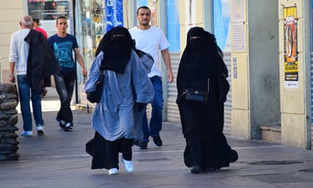 Two women in Marseille defying France's ban on wearing the burqa