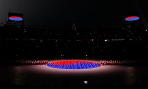 An array of dancers perfected a yin and yang sign in the colours of the South Korean flag, drawing huge applause from the crowd.