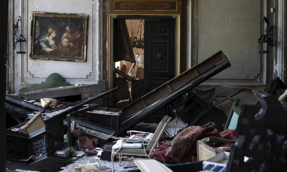 A painting hangs on the wall of a heavily damaged room in the Sursock Palace.