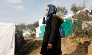 Jalila, 18, stands on the path where she slept on her first night in the Moria camp.