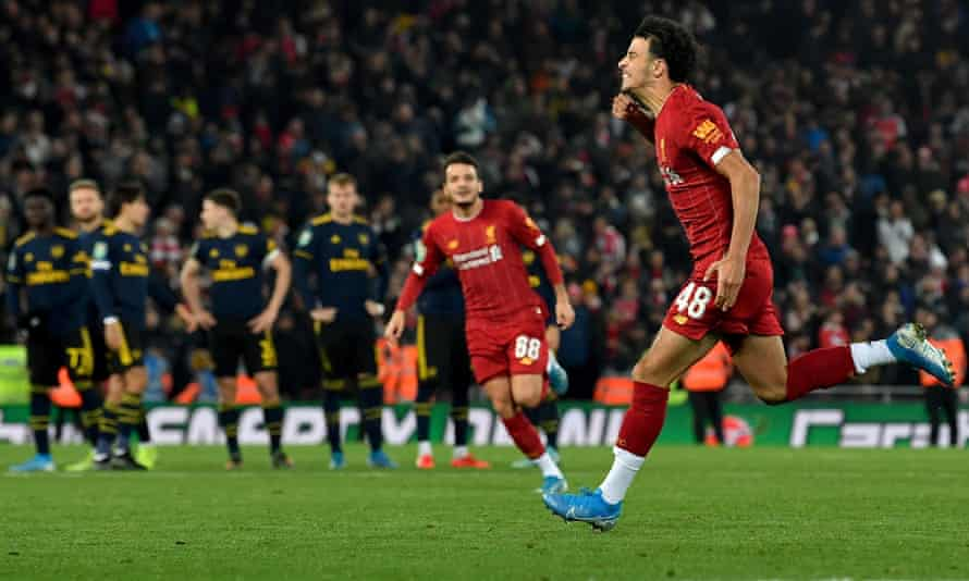 Curtis Jones (right) celebrates after scoring the winning Liverpool penalty in the shootout against Arsenal. It had finished 5-5 after 90 minutes.