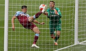 Fabian Balbuena and Lukasz Fabianski of West Ham United clear the ball.