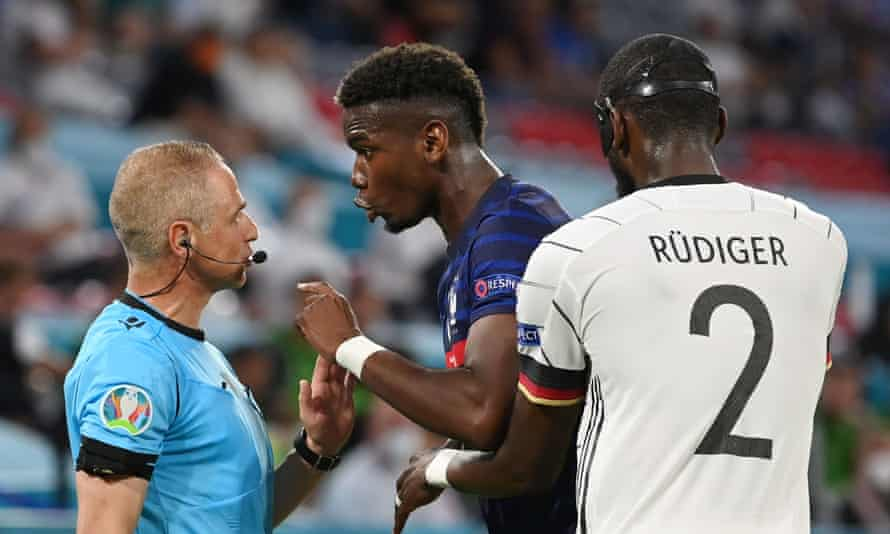 Paul Pogba remonstrates with the assistant referee after the incident, where Germany's Antonio Rüdiger appeared to try and bite his opponent.