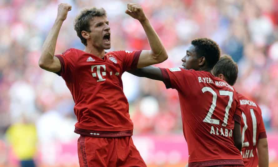 Thomas Müller celebrates after his last-gasp penalty for Bayern Munich.