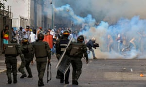 Opposition demonstrators clash with security forces during a protest against the government of Nicolás Maduro in Caracas on Wednesday.