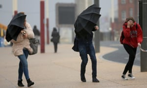 Students brave high winds and rain on Blackpool promenade the remnants of hurricane Gonzalo reach Britain's coast.