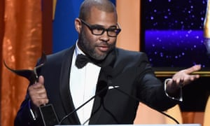 Get Out's writer-director Jordan Peele accepts a Writers Guild of America award for best screenplay on 11 February.