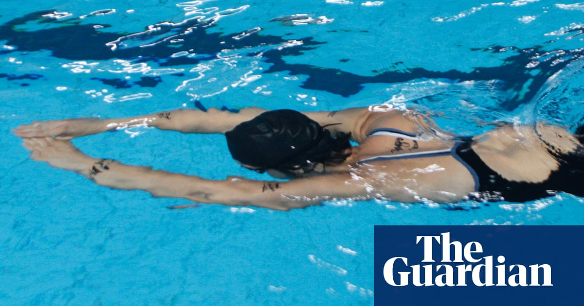 Anger after high school swimmer disqualified for suit that broke modesty rule