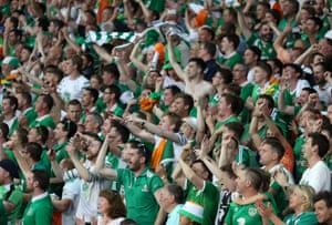 Republic of Ireland fans in the stands celebrate Robbie Brady's goal