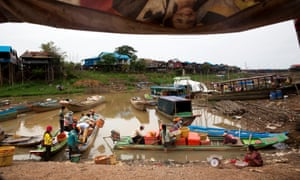 Fishermen in boats sort fish into containers on Tonlé Sap lake in Kampong Khleang, Siem Riep province, Cambodia, on 26 June 26 2015.