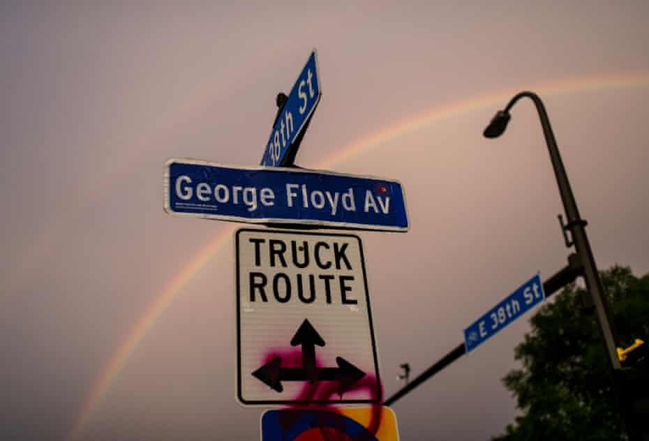 A decal pasted onto a 38th Street sign marks George Floyd Avenue.