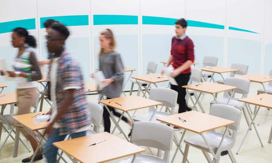 blurred teenagers leaving a classroom