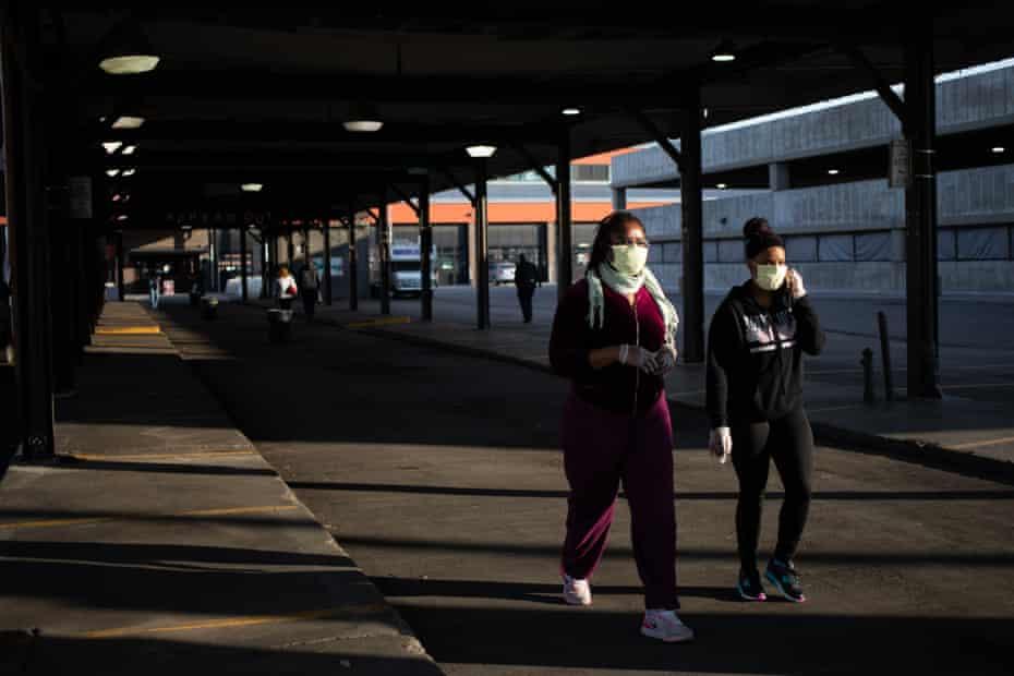 Pedestrians wearing protective masks walk near the Eastern Market in Detroit, Michigan, U.S.