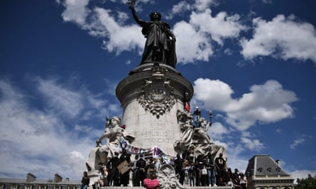 People gather on the statue of Marianne on Place de la Republique in Paris on June 13, during a Black Lives Matter rally.