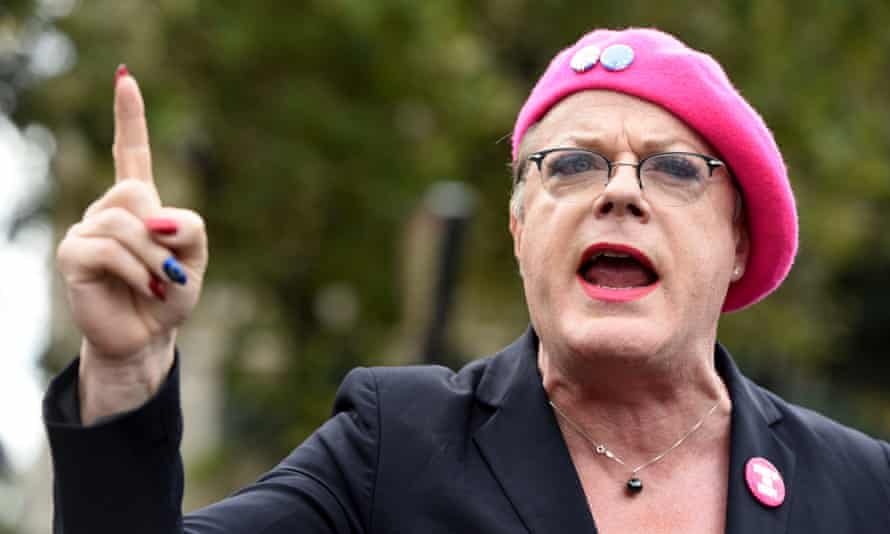 Eddie Izzard wearing red lipstick, and eye make up at a public event
