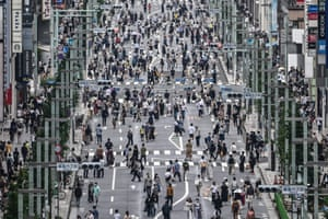 Shoppers flock to luxury stores in Ginza district amid a rise in Covid-19 cases among workers, some infected during after-work socialising.