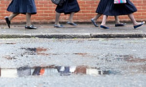 Students leave Beis Malka school in north London, where women have been banned from driving children to school.