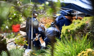 Authorities sift through dirt as they search the former home of missing woman Lynette Dawson, at Bayview on the northern beaches.