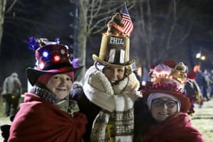 Lisa Gibson of Pittsburgh and her daughters, Josie and AneGiguere, arrive early to celebrate the 133rd Groundhog Day