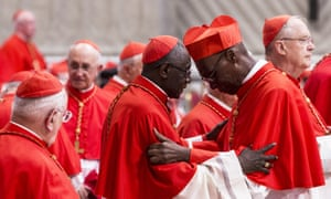 Newly appointed Cardinal Jean Zerbo of Mali is greeted during a consistory ceremony lead by Pope Francis.