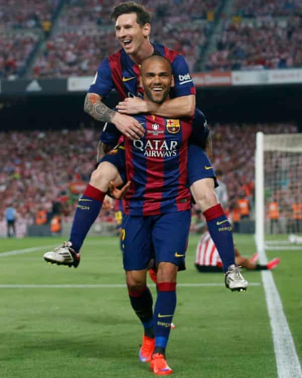 Lionel Messi and Dani Alves.