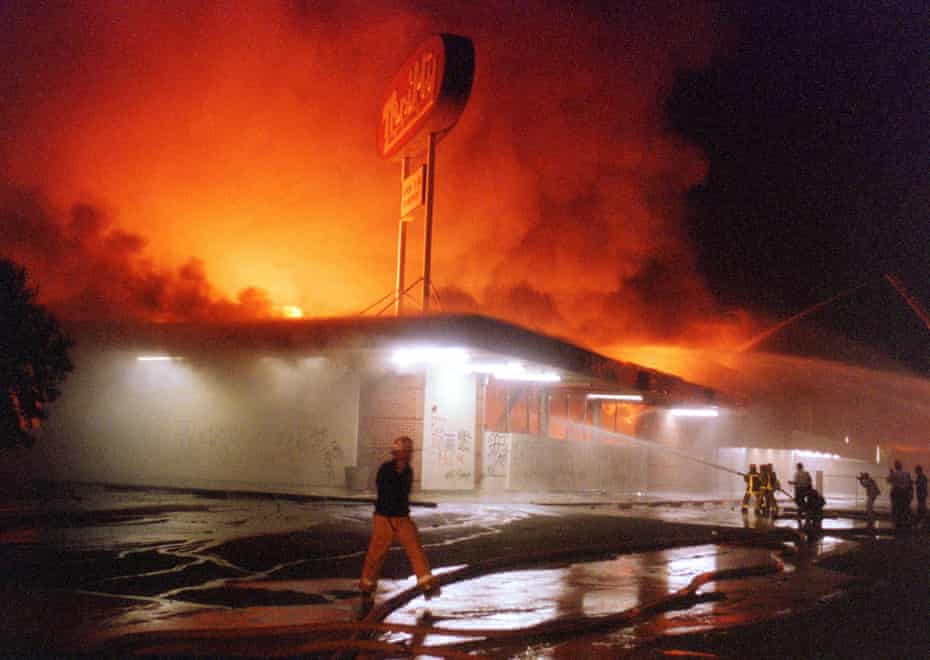 Flames roar from a Thrifty Drug store in the Crenshaw area of Los Angeles on 29 April 1992.