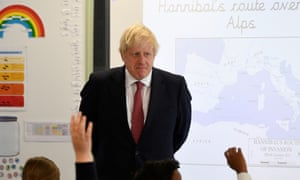 Boris Johnson attends a year six history class during his visit to Pimlico primary school in London.