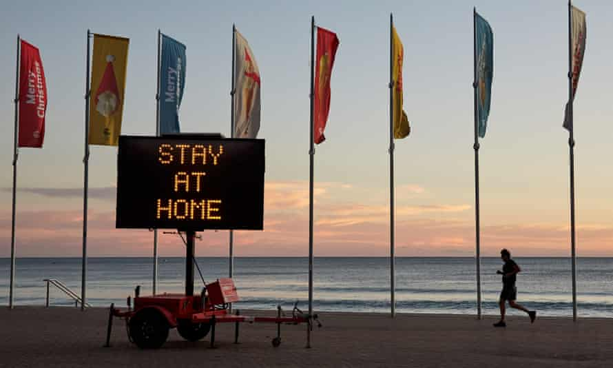 A COVID-19 digital sign is seen at Manly Beach on December 23, 2020 in Sydney, Australia.