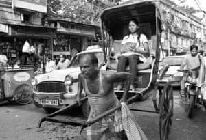 A rickshaw driver negotiates the bussy streets of Kolkata