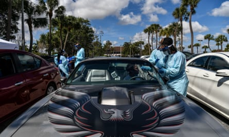 """Medical personnel take medical samples at a """"drive-thru"""" coronavirus testing lab in West Palm Beach"""