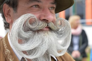 """A participant poses for photographers during the """"World Beard Championship"""" in Leogang, in the Austrian province of Salzburg"""
