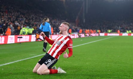 Oli McBurnie of Sheffield United celebrates making it 3-3 but there was a long VAR check for handball before the goal was allowed.
