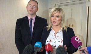 Sinn Fein vice president Michelle O'Neill with party colleague Chris Hazzard speaking to the media in the Europa Hotel, Belfast, yesterday.