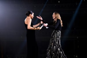 The Duchess of Sussex presents the British womenswear designer of the year to Clare Waight Keller at the 2018 awards
