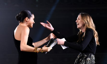 The Duchess of Sussex presents the UK designer of the year womenswear award to Clare Waight Keller