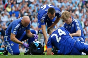 Gary Cahill receives medical attention.