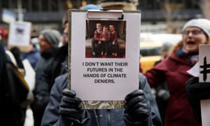 Demonstrators gather protesting climate change outside the office of U.S. Senator Charles Schumer (D-NY) in New York, U.S., January 9, 2017. REUTERS/Shannon Stapleton