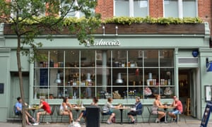 People sit outside a Carluccio's restaurant in 2013