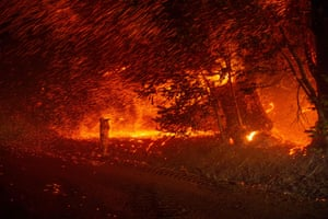 A photographer shoots images amid a shower of embers during the Kincade wildfire in California.