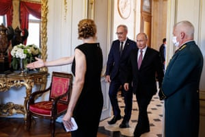 Putin, right, and the Swiss president, Guy Parmelin, centre are led to their meeting room