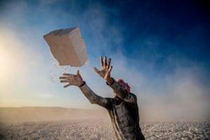 A man throwing bricks
