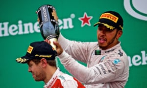 Lewis Hamilton celebrates his victory in Montreal with the second-placed Sebastian Vettel.