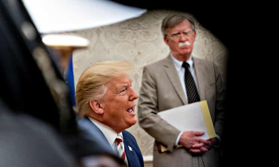 Donald Trump speaks as John Bolton, national security adviser, listens in August 2019.