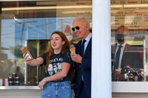 Joe Biden poses for a photo with a girl after getting an ice cream at Honey Hut Ice Cream in Cleveland, Ohio.