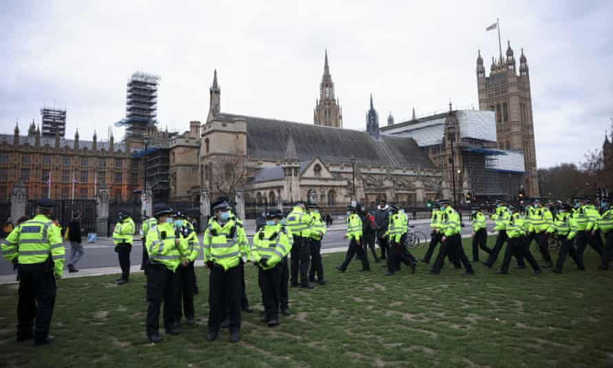 Police stand near Houses of Parliament