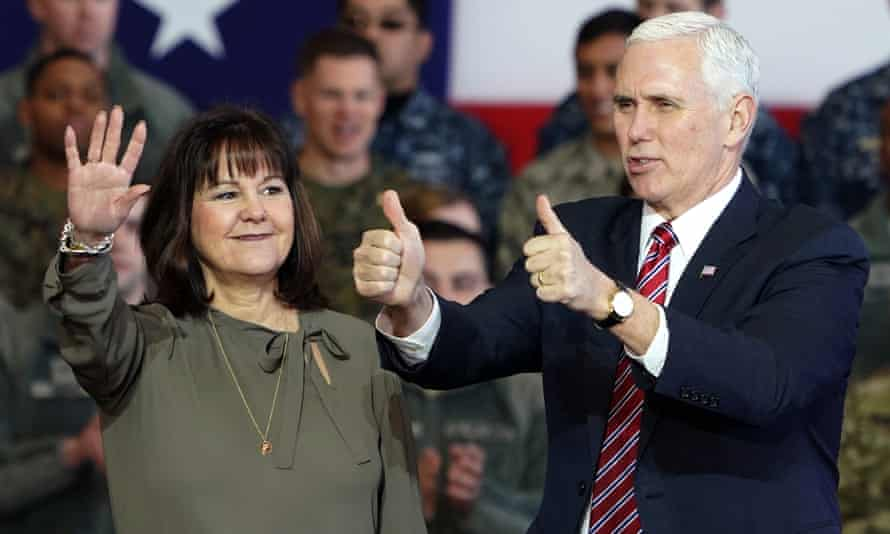 Karen Pence and husband, Vice President Mike Pence, waving to US troops at the Yokota Air Base on the outskirts of Tokyo