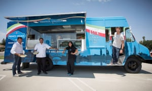 Prince Emanuele Filiberto of Savoy and his partner the the Viscount Paolo Lasagna of Monte Magno, with chefs Mirko Paderno and Mia posing in front the food truck.