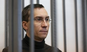 Alexei Kulikov, a former shareholder at Promsberbank, sits in the courtroom at Podolsk city court.