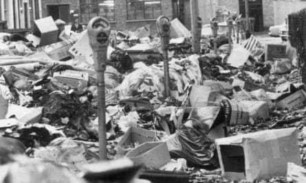 Hoxton Square in October 1970: parking meters stand amid piles of rubbish, accumulated because of a strike by council binmen. (Photo by Leonard Burt/Central Press/Getty Images)