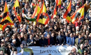 Pro-bullfighting supporters wave flags adorned with bull image as they demonstrate in Valencia on Sunday 13 March 2016.